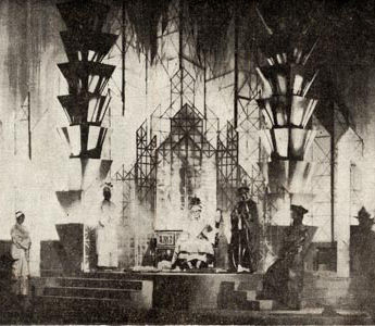 """A setting for """"Marco Millions,"""" Eugene O'Neill's play which was produced by the Community Arts Association Drama Branch in April, 1930 under Irving Pichel. The setting was by Malcolm Thurburn, now living in Los Angeles. Music for two pianos and percussion was composed for the play by Mildred Couper. This was one of the most elaborate and spectacular plays in the history of Lobero Theater. It came at the crest of the wave before the depression and the withdrawal of the Carnegie Grant changed the fortunes of the Association."""