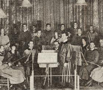 "One of the early pictures of the Community Arts String Orchestra in costumes designed by Adele Herter, Roger Clerbois at the conductor's stand. Concertmaster is Anthony van der Voort; first 'cello, Harry Kaplun; second 'cello, Roscoe Lyans; first desk, second violins, Margaret Ellison (now Mrs. Roy C. Beckman of Florida;) behind her is Fred Greenough, violinist; and seated behind her husband is Mrs. Clerbois, violist. The harpist is Mrs. Lyans. An early record of the orchestra personnel says 12 were professionals and the other nine ""consisted of two students, a gardener, a taxi driver, a bank president's wife, a horticulturist, a curio shop keeper and a chemist."""